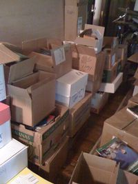 (Picture: Moving boxes at our new house still waiting to be unpacked.)