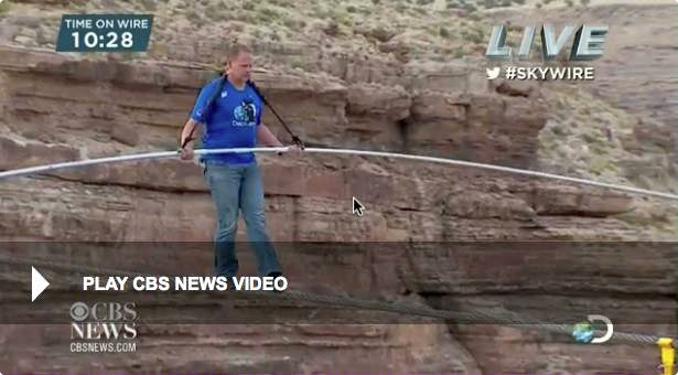 Photo of Nik Wallenda, walking across a gorge near the Grand Canyon