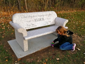 Placing Flowers At Lana's Bench