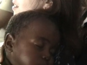 Lana Holding Sleeping Orphan in Swaziland