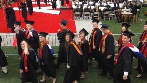 Karis (center, waving) graduating from Liberty on May 10, 2014