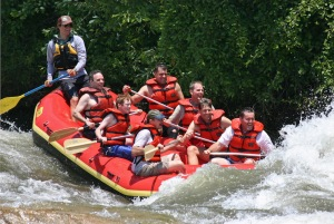 White-water rafting in northern California with my son, Lucas, (middle-left) and my friend, Al Lowry (bottom-left). I'm on the top-left next to the guide. (June, 2005)